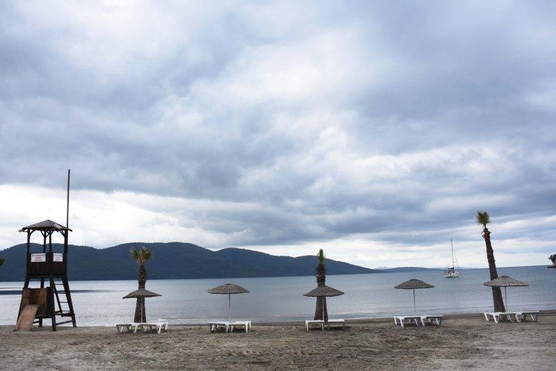 Muğla'nın sahillerinde sosyal mesafeli deniz ve güneş keyfi dönemi