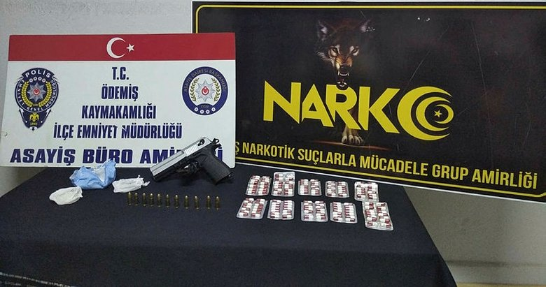 İzmir'de durdurulan araçta uyuşturucu ve tabanca ele geçirildi