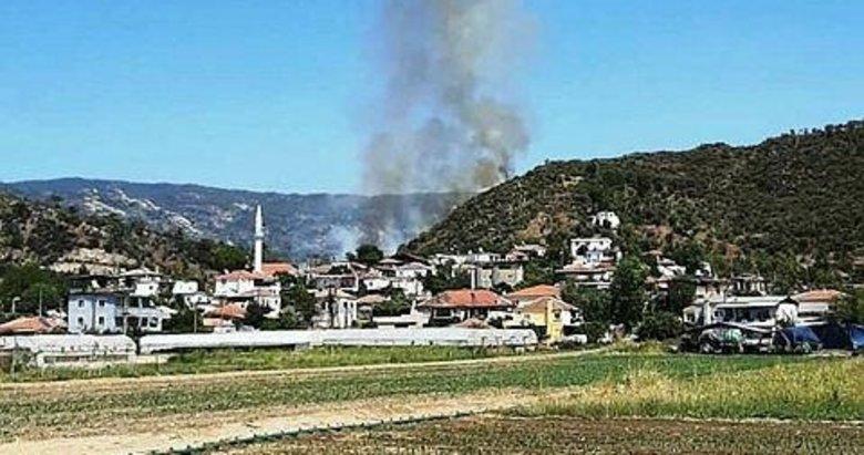 Milas'ta yerleşim yerleri yakınında orman yangını