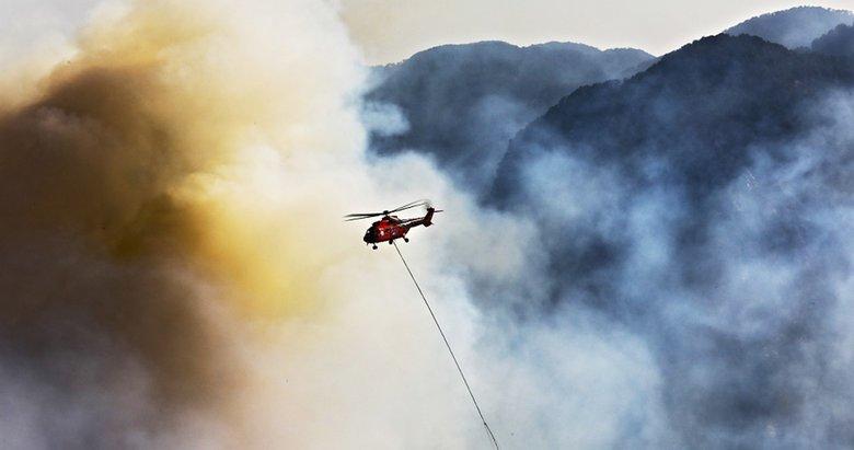 Marmaris'te yangınla mücadele devam ediyor! Kırmızı helikopterden kritik görev