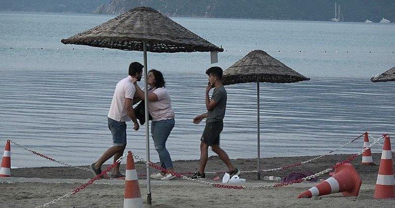 Marmaris'te kadın ile erkeğin plajdaki tekme- tokat kavgası kamerada
