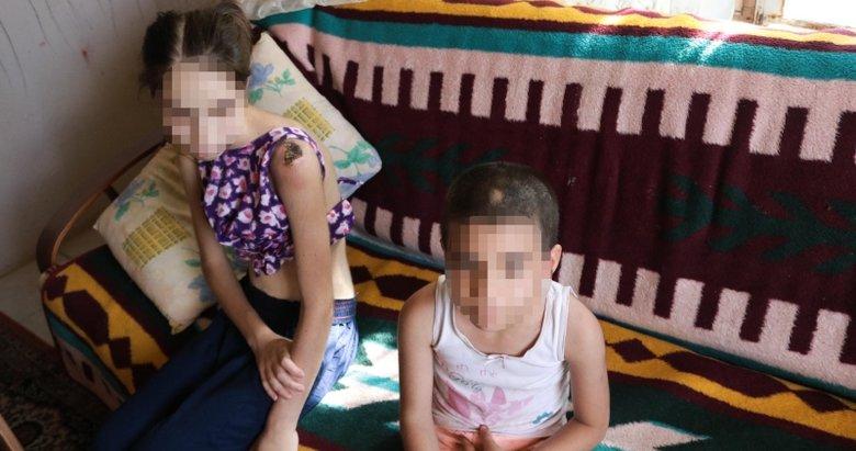 İzmir Foça'da kan donduran iddia! Üvey babadan iki kardeşe keser sapıyla şiddet
